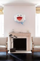 Marble fireplace with quirky wall mounted sculpture