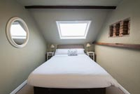 Double attic bedroom with open brick alcoves