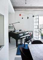 Small grand piano in modern apartment