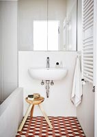Sink in modern bathroom with wooden stool
