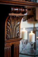 Detail of classic wooden carved fireplace surround