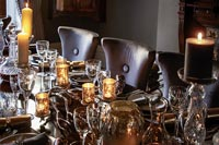 Classic dining room table with crystal glassware and candles
