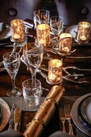 Decorative candle holders on dining table laid for Christmas dinner