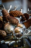 Decorative pine cones and silver baubles