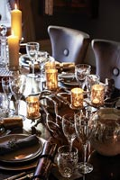 Decorative glass candle holders on dining table at Christmas