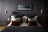 Modern bedroom with dark painted walls