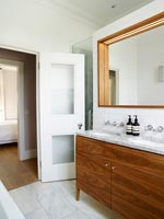 Modern twin sink cabinet in bathroom