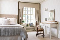 Classic bedroom with dressing table and window seat