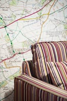 Map wallpaper and striped furniture
