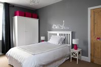 Childrens bedroom with storage and lamps