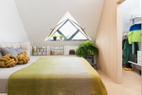 Modern bedroom with triangular window