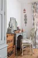 Modern bedroom with painted dressing table and vintage chair