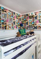 Bunk bed and feature wall of comics in childrens room