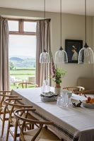 Modern country dining room with countryside views