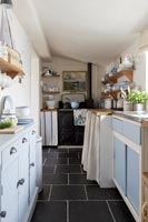 Galley kitchen with blue cabinets