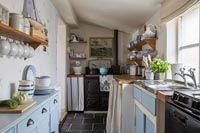 Galley kitchen in seaside cottage