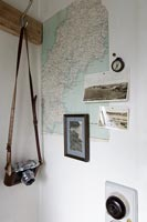 Map, photographs and vintage camera