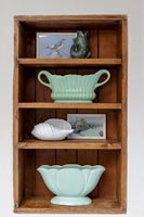 Wooden alcove shelves with display of collectibles