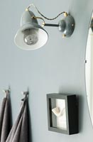 Grey wall mounted retro lamp on grey painted wall