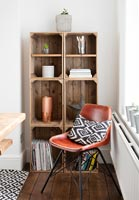 Leather chair by shelves made of old crates