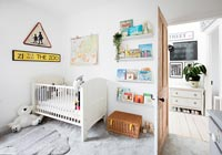 Modern nursery with cot and book shelves