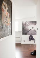 Modern artwork on walls of corridor and living space
