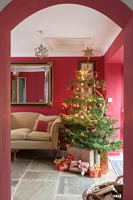 Red living room with Christmas tree