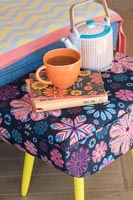 Colourful modern floral footstool with teapot and cup