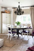 Stone floor in eclectic country dining room
