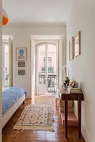 Open French windows in classic bedroom