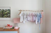 Homemade clothes rail for baby clothes