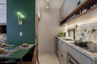 Green wooden frame with built in dining table in kitchen
