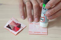 Woman using glue stick - crafting
