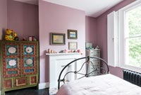 Pink bedroom with painted oriental style wardrobe