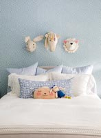 Wall mounted decorative toy animal heads in childs bedroom