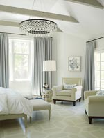 Classic bedroom with large chandelier