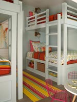 Bunk beds in childrens room with colourful bedding