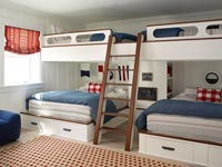 Nautical themed bedroom with ships bunk beds