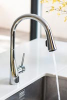 Modern kitchen faucet with running water