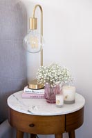Modern lamp on marble topped bedside table
