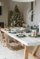 Dining table laid for Christmas