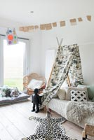 Tepee style canopy over childrens bed