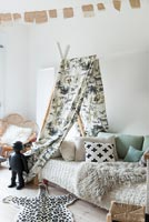 Tepee style canopy over daybed in childrens room