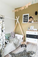Modern childrens room with triangular bed frame for canopy