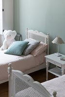 Pastel cushions on childrens bed