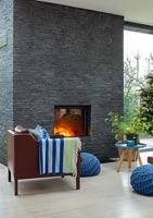 Slate wall with lit fireplace in modern living room
