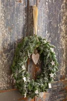 Christmas wreath on distressed wooden doors