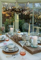 Classic dining table in Victorian conservatory at Christmas