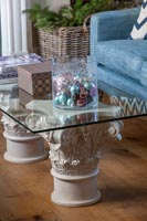 Glass top coffee table with stone pedestals