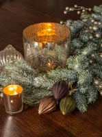 Christmas decorations and candles on table